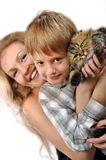 Happy mother and son with a cat. Portrait of a happy familyr with a cat Stock Photography