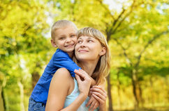 Happy mother with son. Happy mother with child son having fun in park Stock Photo
