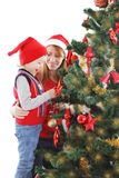 Happy mother and son decorating Christmas tree Royalty Free Stock Photos