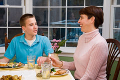 Happy Mother and son at dinner table Royalty Free Stock Photos