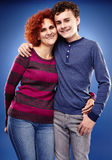 Happy mother and son embracing each other. Studio shot of a happy mother and son embracing each other stock photos