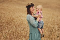 Happy mother with son in the field Royalty Free Stock Photo