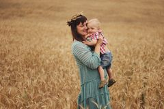 Happy mother with son in the field Royalty Free Stock Photography