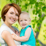 Happy mother and son at field Royalty Free Stock Images