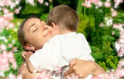 Happy mother and son with flowers Stock Photography