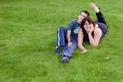 Happy mother and son on the grass. A happy moter and son on the garden grass Royalty Free Stock Image