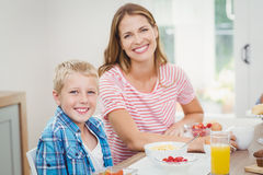 Happy mother and son having breakfast Royalty Free Stock Images