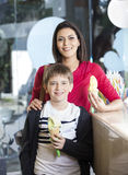 Happy Mother And Son Holding Vanilla Ice Cream Cones Stock Photography