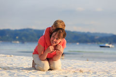 Happy mother and son hug on beach vacation Royalty Free Stock Image