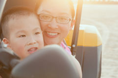 Happy mother and son on kart Stock Image