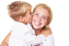 Happy mother and son kissing. On cheek over white Stock Images