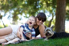 Happy mother and son on a lawn Royalty Free Stock Photo