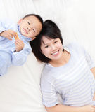 Happy mother and son lying on bed Royalty Free Stock Photo