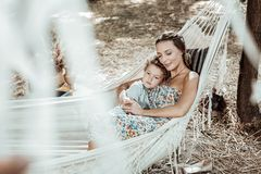 Happy mother and son lying in a hammock
