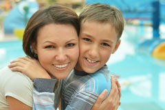 Happy mother and son near pool Royalty Free Stock Photos