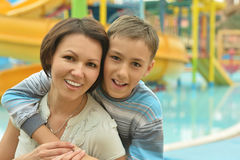 Happy mother and son near pool Royalty Free Stock Photography