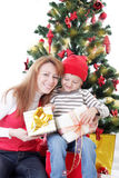 Happy mother and son opening gifts Stock Photos