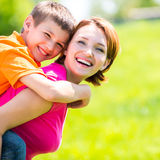 Happy mother and son outdoor portrait Stock Photos
