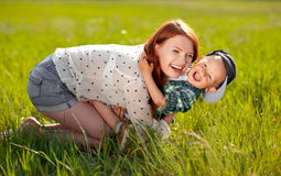Happy mother with son outdoors Stock Image