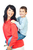 Happy mother and son in piggy back. Happy mother and son with missing teeth in  piggy back isolated on white background,check also in this collection series Royalty Free Stock Photos