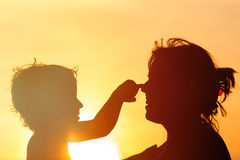 Happy mother and son play at sunset. Sunlight Royalty Free Stock Photography