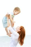 Happy mother and son playing. Outdoors Royalty Free Stock Image