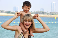 Happy mother and son playing on the beach Stock Photo
