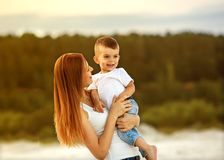 Happy mother and son playing Stock Photo