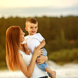Happy mother and son playing Royalty Free Stock Images