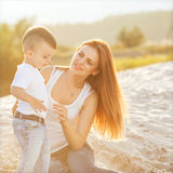 Happy mother and son playing Stock Photos