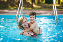 Happy mother with son in pool Stock Photos