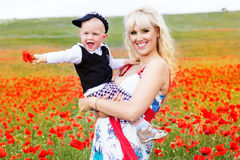 Happy mother and son on the poppies field Royalty Free Stock Photography