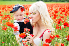 Happy mother and son on the poppies field Royalty Free Stock Photo