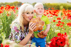 Happy mother and son on the poppies field Stock Photography
