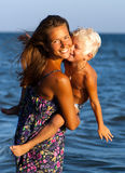 Happy mother and son in sea Royalty Free Stock Images