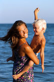 Happy mother and son in sea Royalty Free Stock Image
