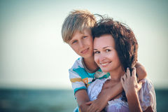 Happy mother and son at sea, outdoor Stock Photos