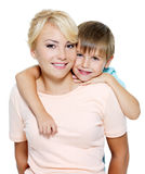 Happy mother and son of six years. Happy portrait of the mother and son of six years. Isolated on white Stock Photos