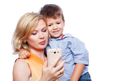 Happy mother with son and smartphone Stock Images