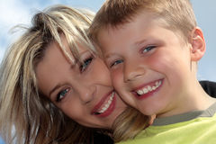Happy mother and son smiling. Closeup Stock Image