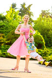Happy Mother and son spinning in summer park Royalty Free Stock Photo
