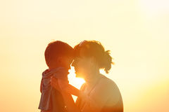Happy mother and son at sunset Stock Images