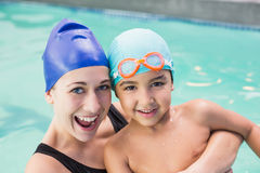 Happy mother and son in the swimming pool Stock Photos