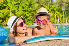 Happy mother and son in the swimming pool Stock Images