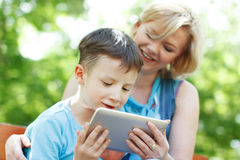 Happy mother and son with tablet Royalty Free Stock Photo