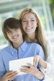 Happy mother and son with tablet Royalty Free Stock Image