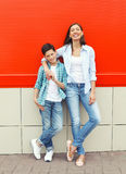 Happy mother and son teenager wearing casual clothes in city. Happy mother and son teenager wearing a casual clothes in city Royalty Free Stock Photography