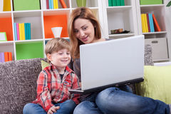 Happy mother and son using computer Stock Images