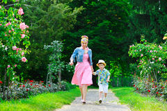 Happy Mother and son walking in summer park with Royalty Free Stock Photos