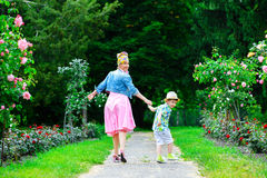 Happy Mother and son walking in summer park with Royalty Free Stock Photo